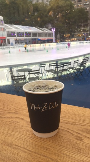 Coffee at Bryant Park- watching skaters in the rain